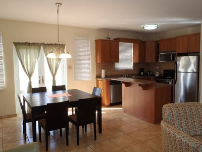 Isabela house rental - Living room to dining and kitchen areas. Open floor plan.