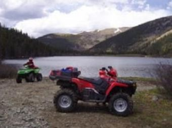 ATV in the majestic snow capped mountains..only minutes from the front door.