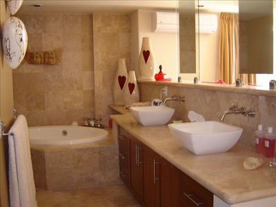 Master Ensuite with separate shower, sunken tub and private toilet