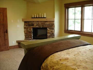 View of typical master bedroom with fireplace.