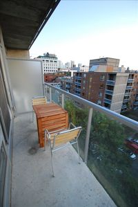 Sunny balcony with view of CN Tower & lively Queen street
