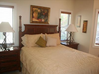 The bright second bedroom has a queen bed, cozy bay window and private bathroom.
