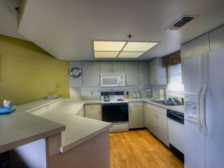 St Pete Beach condo photo - Kitchen (new flooring) has everything you'll need to cook with during your stay.