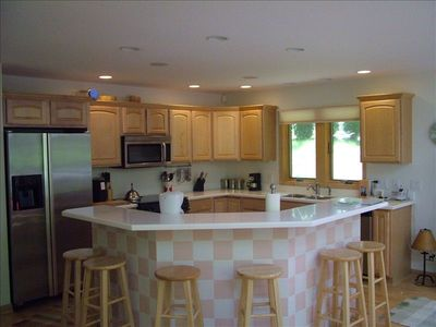 Kitchen has all the amenities needed to cook or serve gourmet meals.