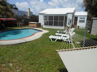 Lake Worth house photo - The pool with chaise lounges, hammock and cabana.