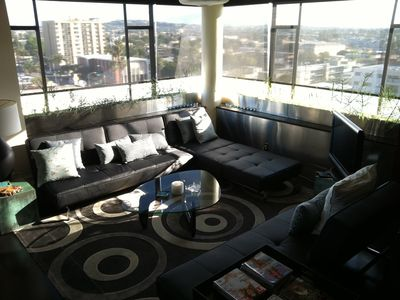 Living room with 270 degree panoramic views. Sofas fold flat to 2 full size beds