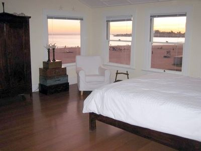 Large master bedroom with beach views, leather couch, and seating area