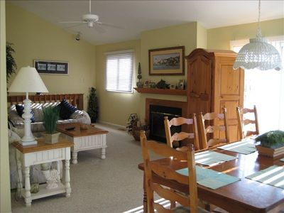 Large Living and Dining Area with Fireplace, Vaulted Ceiling, Bay View