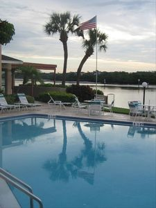 Relax with scenic views from your heated waterfront swimming pool.