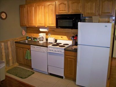 Kitchen fully stocked - fridge, oven, microwave, coffeepot, toaster, utensils