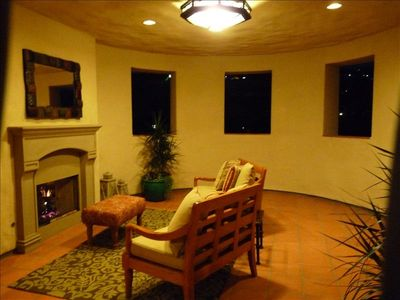 Enter thu golf course view private loggia with cozy fireplace & seating area!