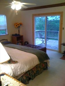 Master bedroom has a king bed, a private upstairs deck and newly renovated bath.