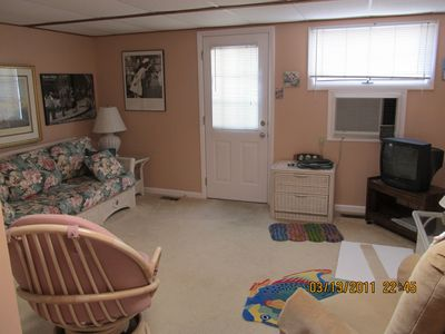 Family Room with exit to rear private parking