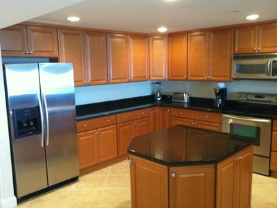 Kitchen and kitchen island. A dishwasher and microwave are included.