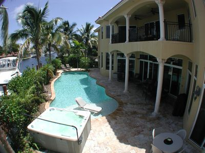 Waterfront, fenced, huge pool, hot tub, pool fence optional, large patio & balc