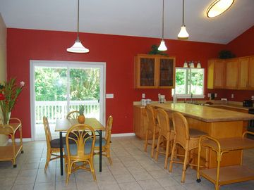 Dining Room & Kitchen w/ stainless appliances, back deck/pool access