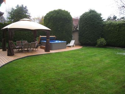Trees and hedges provide full privacy on the backyard
