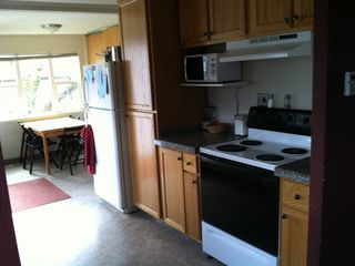 Portland house photo - Kitchen stove, cupboards and kitchen nook.