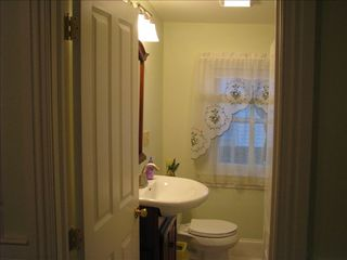 Cape May house photo - 1st floor half bath w/stacked washer & dryer