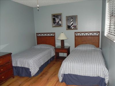 Hardwood floors compliment this 1st floor bedroom.