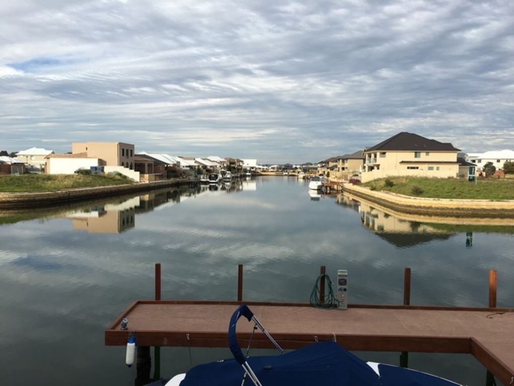 Large family friendly absolute waterfront canal home with private jetty