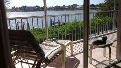 Relax and the screened lanai watching dolphin in the bay waters.