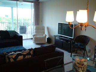 Vanderbilt Beach condo photo - Large flat screen TV with DVD player