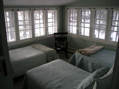 Sleeping porch with 3 twin beds