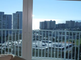 Daytona Beach Shores condo photo - panoramic city views from living room and balcony