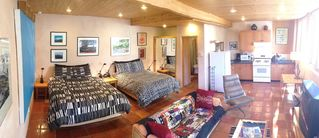 Taos house photo - Wide angle of 1 st floor studio apt with 2 queen beds,full bath and kitchen.