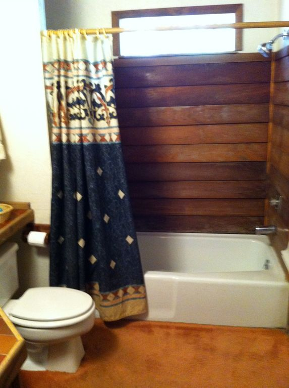 Downstairs Bathroom With tub, shower, washer, and dryer