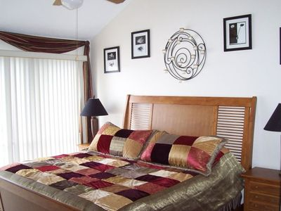 Osage Beach condo rental - Master bedroom with King bed and adjoining bath. Also lake view!!!!