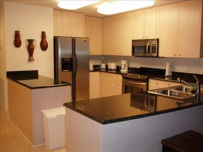 Deluxe Kitchen has granite countertops and stainless appliances