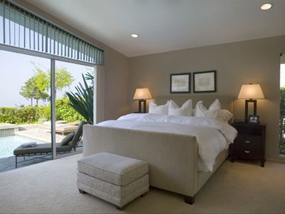 Tranquil Master bedroom with pool access and views.