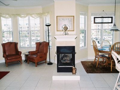 Entry into living, dining rm, with gas fireplace and picturesque views of marina