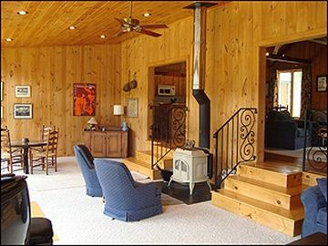 Sunken family room with wood stove.