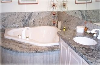 Master suite bath, which includes jacuzzi tub, shower, and double sink.