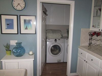 laundry room off kitchen with laundry products supplies