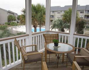 Harbor Island house photo - Enjoy al fresco dining on the screened porch. Pool to south, ocean to the east