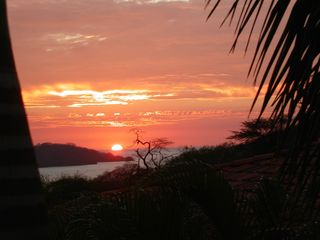 Playa Hermosa villa photo - Sunset view was taken from my terrace. Now view is less because of tree growth.
