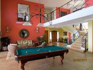 Nosara villa photo - Great room looking to the entry and upstairs guest bedroom.