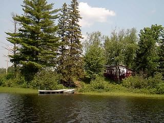 Michigamme River cabin photo - River view of fishing boat at dock from pontoon.
