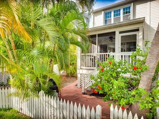 Key West house photo - A spacious screened porch faces the fairway with a nature pond.