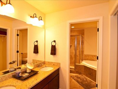 Master bathroom with twin vanities and 2-person jetted tub.