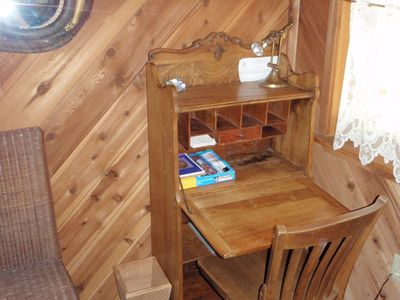Douglas City cabin rental - Antique secretary has a hardwire for internet plus strong light for tying flies