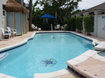 saltwater pool w/umbrella table, lounges, floats, shared with 2 small units