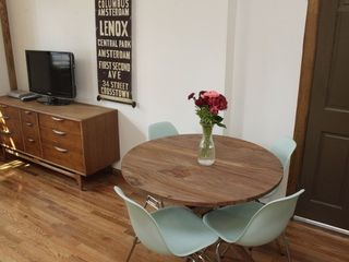 Queens studio photo - Mid-Century Modern Solid Walnut Furniture and Classic Eames Chairs.