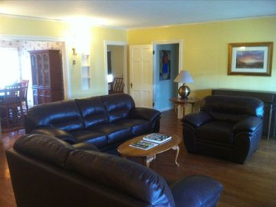 Alpine house rental - Open living room with leather couches, gas fireplace, and piano