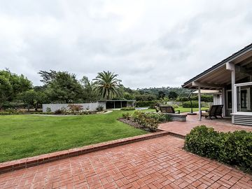 Hope Ranch chateau / country house rental - Large Resort-like backyard with views of open skies and lush landscaping