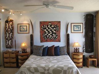 Kihei condo photo - Master Bedroom with Tongan turtle tapa and Papua New Guinea shields